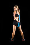 Toned young fitness woman working out. stock photos