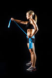 Toned young fitness woman working out. Stock Photography