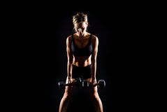 Toned young fitness woman working out. Royalty Free Stock Photography