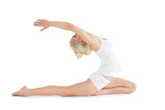 Toned young woman stretching hands backwards Royalty Free Stock Images