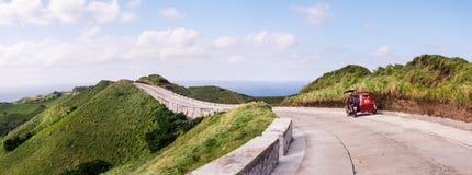 Toneelweg bij de Rolling Heuvels van Vayang, Batanes, Filippijnen Stock Afbeeldingen