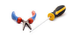 Tong with Screwdriver Royalty Free Stock Photos