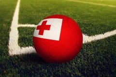 Tonga ball on corner kick position, soccer field background. National football theme on green grass.  stock illustration