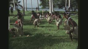Tonga Battle Dances. FRENCH-POLYNESIA, TONGA, JANUARY 1976. Two Shot Sequence Of Tonga Male Warrios Performing Battle Dances During The Royal Kava Ceremony stock video footage