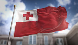 Tonga Flag 3D Rendering on Blue Sky Building Background Royalty Free Stock Images