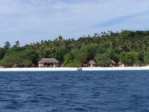 Tonga Island shoreline Huts Stock Photography