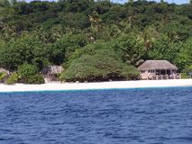 Tonga Island shoreline Huts 2 Stock Photos