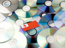 Tongan flag on top of CD and DVD pile isolated on white. Tongan flag on top of CD and DVD pile isolated Stock Image