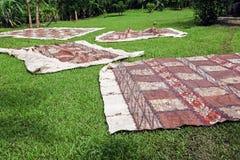 Tongan tapas drying on the grass Stock Image