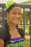 Tongan teenager. Beautiful Tongan girl wearing colorful flower in her hair and a traditional Tongan skirt. Photo taken on: July 22nd, 2013 royalty free stock image