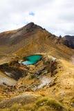 Tongariro National Park. Chasing the beautiful Emerald Lakes Stock Images