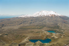 Tongariro Volcano and Lakes, New Zealand. Tama Lakes and Ruapehu volcano as seen from the top Ngauruhoe volcano, Tongariro trek, New Zealand stock photo