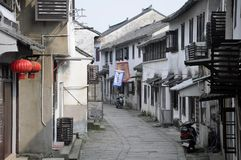 Tongli Town Jiangsu Province China Street. Ancient Chinese architecture and buildings lining a narrow stone street within Tongli Town in Jiangsu Province China Stock Photo