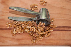 Tongs for chopping walnuts and shelled walnut Stock Image