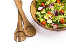 Tongs paired with salad bowl Royalty Free Stock Photos