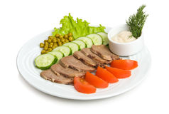 Tongue appetizer. With tomatoes, cucumber, green peas and sauce Royalty Free Stock Photo