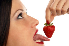 Tongue on Berry Woman Eats Strawberry Fruit Royalty Free Stock Photo