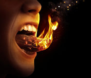 Tongue on fire. Close up of a tongue that is on fire stock image
