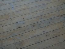 Tongue and groove floorboards. Before being treated showing paint stains and knotted wood royalty free stock photos
