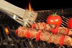 Tongue Hold BBQ Beef Shish Kebab With Vegetables On The Hot  Fla Stock Photos