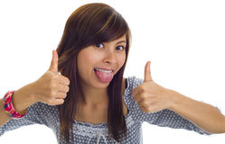 Tongue out and thumbs up. Beautiful woman sticking tongue out and showing two thumbs up, isolated on white royalty free stock image
