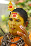 Tongue pierced God woman. An unidentified self proclaimed god woman with her tongue pierced with a spear participate in the Pooram Festival held on April 24 Royalty Free Stock Photo