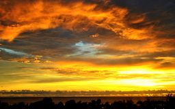 Tongues of Fire. In the clouds as the sun sets in Saipan, Northern Mariana Islands Stock Images