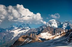Mountain, slope, top, glacier, stone wall, snow, ice stock images