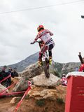 Toni Bou at Spanish National Trial Championship. LA NUCIA, SPAIN - FEBRUARY 11th 2018: 11 time world champion Toni Bou from Repsol Honda Team jumps over an Royalty Free Stock Photography