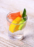 Tonic lemonade with grapefruit, lime, lemon and ice Royalty Free Stock Photo