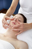 Tonifying facial massage at the spa Stock Photography