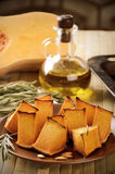 Toning effect baked pumpkin, rosemary and olive oil on a kitchen Royalty Free Stock Photo