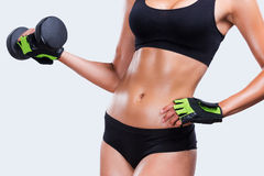 Toning her muscles. Stock Photos