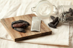Tonka bean. S on a wooden plate and with a grater Stock Photo