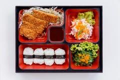 Tonkatsu Bento Served with Japanese Rice Wraped, Cut Tonkatsu and Japanese-Style Barbecue Sauce, Seaweed with Ebiko and Kani Salad. Tonkatsu Bento Served with Royalty Free Stock Photography