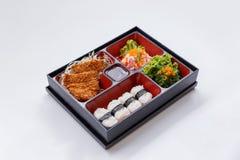 Tonkatsu Bento Served with Japanese Rice Wraped, Cut Tonkatsu and Japanese-Style Barbecue Sauce, Seaweed with Ebiko and Kani Salad Royalty Free Stock Photos