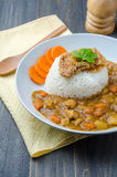 Tonkatsu, Japanese Curry Rice with deep-fried pork cutlet on woo. Den table royalty free stock photography