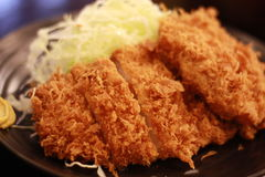 Tonkatsu. A Japanese dish called `Tonkatsu`, deep-fried pork cutlet, served with shredded cabbage Stock Photo