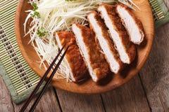 Tonkatsu serve with slice cabbage closeup. horizontal top view Stock Photo
