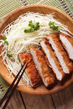 Tonkatsu serve with slice cabbage closeup. Vertical top view Royalty Free Stock Photography