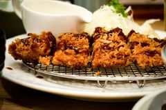 Tonkutsu. Japanese fired chicken serve with salads and sauce royalty free stock images