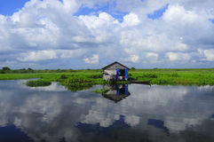 Water village in Cambodia. Floating house on Tonle Sap lake in Cambodia Stock Images