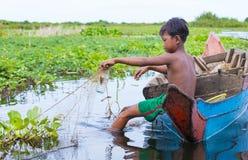 The Tonle sap lake Cambodia. TONLE SAP , CAMBODIA - OCT 18 : Cambodian children in Tonle sap lake Cambodia on October 18 2017. Tonle sap It is the largest lake Royalty Free Stock Photo