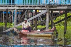 The Tonle sap lake Cambodia. TONLE SAP , CAMBODIA - OCT 18 : Cambodian man in Tonle sap lake Cambodia on October 18 2017. Tonle sap It is the largest lake in Royalty Free Stock Photos