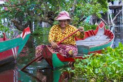 The Tonle sap lake Cambodia. TONLE SAP , CAMBODIA - OCT 18 : Cambodian woman in Tonle sap lake Cambodia on October 18 2017. Tonle sap It is the largest lake in Stock Photos