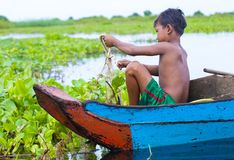 The Tonle sap lake Cambodia. TONLE SAP , CAMBODIA - OCT 18 : Cambodian child in Tonle sap lake Cambodia on October 18 2017. Tonle sap It is the largest lake in Royalty Free Stock Photo
