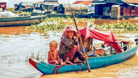 Family on a boat in a floating village on Tonle Sap lake. Tonle Sap Lake Siem Reap, Cambodia - July 13, 2013: Cambodian people live on Tonle Sap Lake in Siem Royalty Free Stock Photos