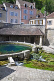 Tonnerre France. Tonnerre in Burgundy France sits on the River Armancon, famed for its Tonnerre Fosse Dionne wash house Stock Photography