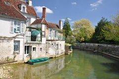 Tonnerre France. Tonnerre in Burgundy France sits on the River Armancon, famed for its Tonnerre Fosse Dionne wash house Royalty Free Stock Photography