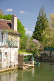 Tonnerre France. Tonnerre in Burgundy France sits on the River Armancon, famed for its Tonnerre Fosse Dionne wash house Royalty Free Stock Image